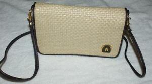 etienne aigner tan purse with symbol on it