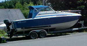 24 ft. inboard motorboat with cuddy