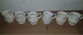 6 x fine bone china flower mugs in immaculate condition. Each mug