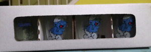 Set of 4 laughing Smurf shot glasses new in bos