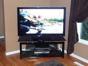 Glass and black steel TV stand