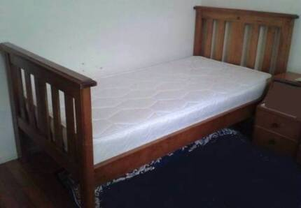 nice solid timber single bed with mattress