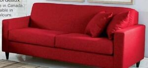 Moving! Need to sell Red fabric sofa - like new condition.