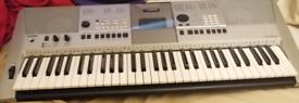 Yamaha PSR E413 piano keyboard with bag cover