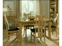 Oak Dinning Room Table and Chairs with matching side board and display cabinet