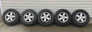 5 Jeep Rims with tires