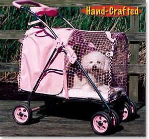 OBO.... PINK  DOG STROLLER BY KITTY WALK