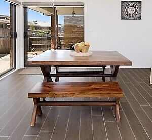 Solid timber dining table with bench stools