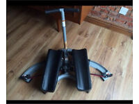 Thigh glider exercise machine