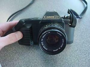 CANON T50 35MM FILM SLR CAMERA W FD 50MM F1.8 LENS - USED $49