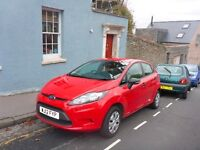 Red 5 door ford fiesta for sale in good condition.