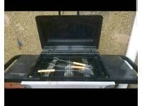 Barbeque with full bottle of gas