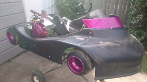 Offset dirt racing go kart and enclosed trailer