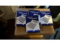 3 boxs of brand new calculators
