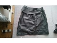 Black leather skirt with detachable belt size 12 for sale.