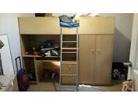 Cabin bed with wardrobe, drawers and desk.