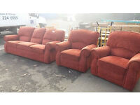 Red fabric 3 piece suite with reclining armchair