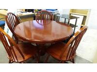 Circular hardwood table with 4 chairs