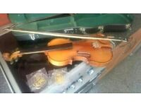 violin in case bow and stringd