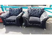 2 stylish black armchairs
