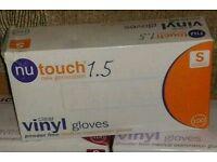 X7 packs of 100 new vinyl gloves