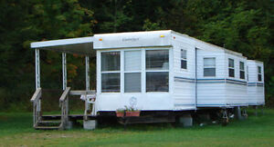 I WANT TO BUY AN OLDER PARK MODEL TRAILER  IN PRINCE EDWARD CTY