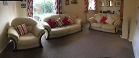 Cream leather three piece suite: 3 seat sofa, 2 seat sofa and chair