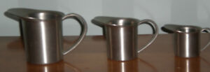 For Sale. Three Aitkens Pewter Creamers/Cups with handles.