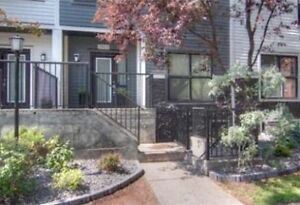 Updated town-home, Private rooftop patio, heated underground par