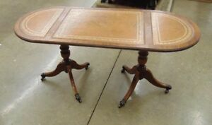 antique coffee table with claw feet on wheels with leather top