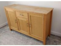 **Light wood sideboard with three cupboards and a drawer**