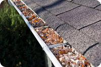 Eaves trough cleaning with roof inspection by journeyman roofer