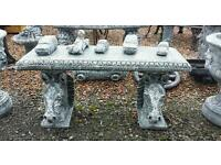 Garden benches with horses heads