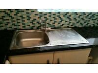 Kitchen sink with tap