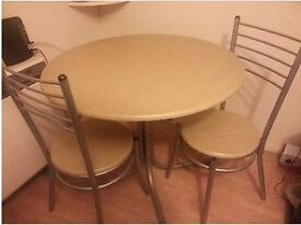 ROUND DINNING TABLE WITH 4 CHAIRS - AS GOOD AS NEW