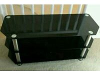 Black glass tv stand in mint condition