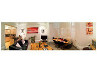 Modern grnd flr 1 bedroom holiday apartment with private parking close to the station and amenities
