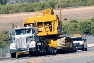 Heavy equipment, freight, car movers services across Canada