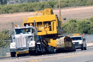 Heavy equipment trucking services in New Brunswick and Canada