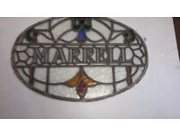 Vintage stain glass oval shaped wording MARRELL in center