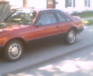 1990 Ford Mustang red Hatchback