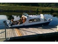 Freeman 22 Mk1 Cabin cruiser. Built 1959 from GRP. Morris Minor petrol engine with shaft drive.