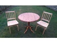 pine drop leaf pine table and 2 chairs