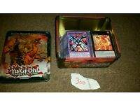 300 yugioh cards with tin