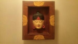 Hand crafted wood frame with Asian sculpted face