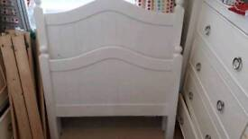 White, wooden single bed frame