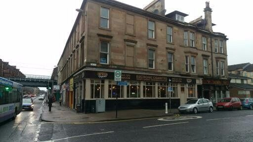 Large one bedroom unfurnished flat to let, first floor, corner location, next to Partick station