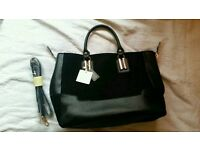 Black suade and faux leather handbag
