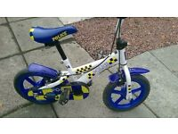 Police toddler bike with stabilisers if needed