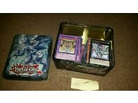 300 joblot of yugioh cards with tin